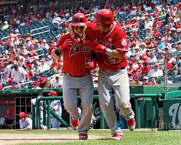 People Poster featuring the photograph Mike Trout and Kole Calhoun by Patrick Mcdermott