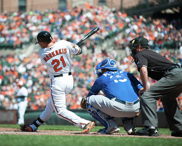 American League Baseball Poster featuring the photograph Nick Markakis by Rob Tringali