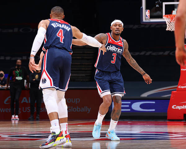 Nba Pro Basketball Poster featuring the photograph Russell Westbrook and Bradley Beal by Ned Dishman