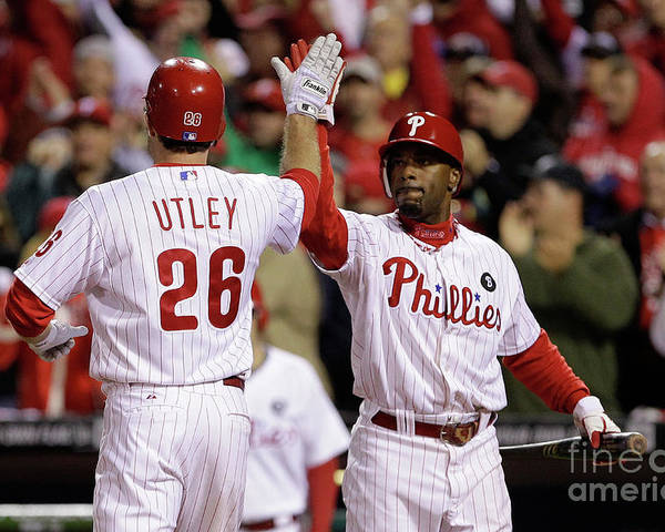 Game Two Poster featuring the photograph Ryan Howard, Jimmy Rollins, and Chase Utley by Rob Carr