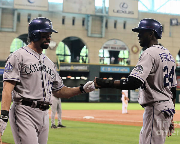 American League Baseball Poster featuring the photograph Todd Helton and Dexter Fowler by Scott Halleran
