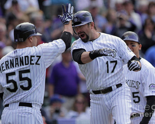 Relief Pitcher Poster featuring the photograph Todd Helton and Ramon Hernandez by Doug Pensinger
