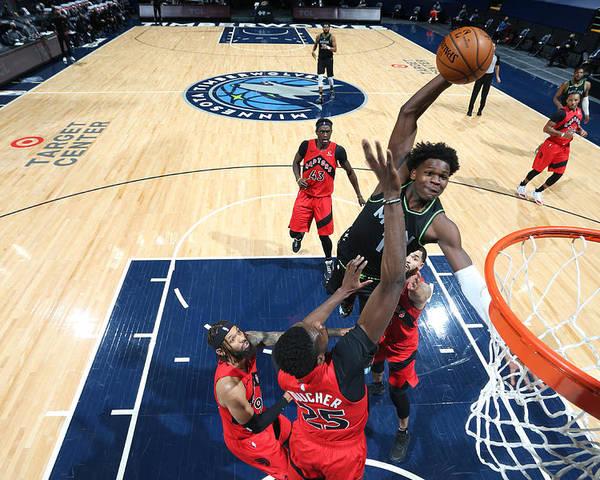 Nba Pro Basketball Poster featuring the photograph Toronto Raptors v Minnesota Timberwolves by David Sherman