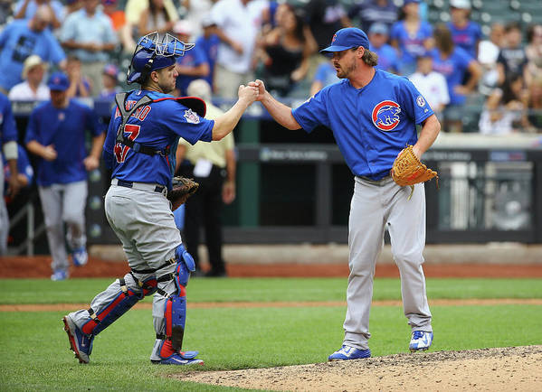 People Poster featuring the photograph Travis Wood and Miguel Montero by Al Bello