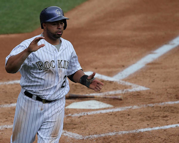 Second Inning Poster featuring the photograph Wilin Rosario by Doug Pensinger
