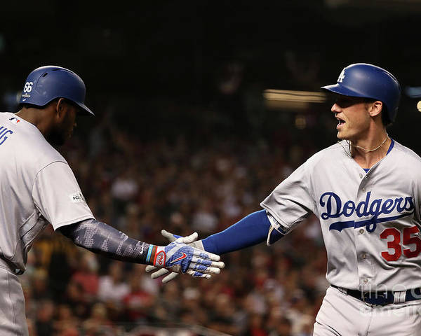 Three Quarter Length Poster featuring the photograph Yasiel Puig and Cody Bellinger by Christian Petersen
