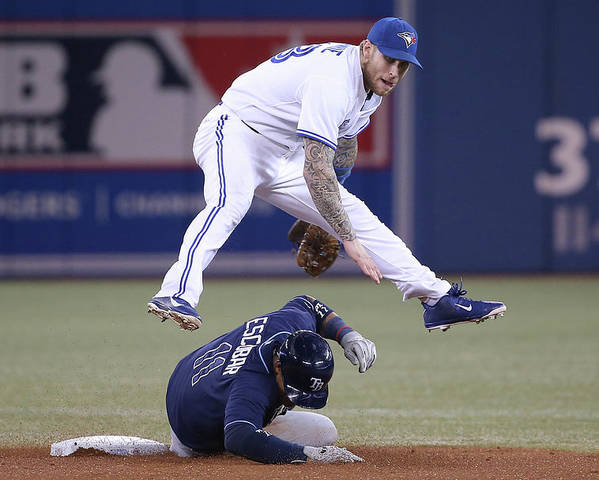 Double Play Poster featuring the photograph Yunel Escobar and Brett Lawrie by Tom Szczerbowski