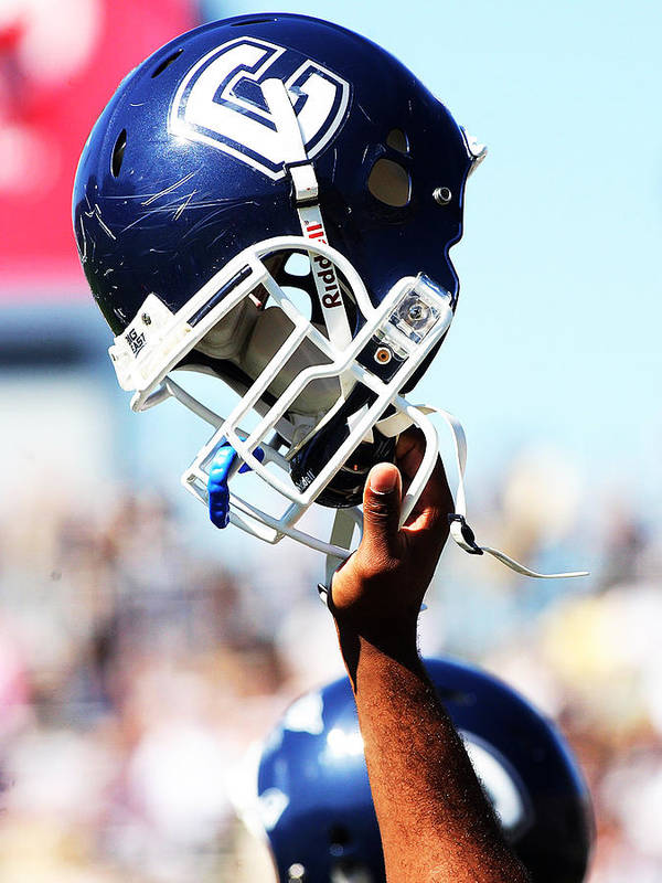 Replay Photos Poster featuring the photograph Uconn Helmet by University of Connecticut
