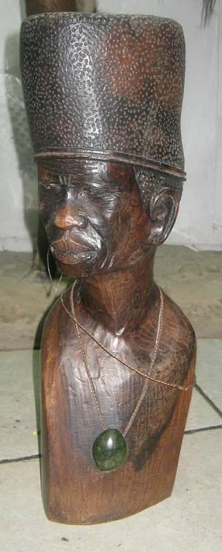 The Chiefs Advicer Wooden Sculpture African Warrior Art Studios African Artists Poster featuring the sculpture Chiefs Advicer by Pending