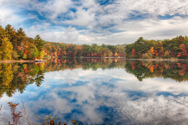 Dawn reflection of fall colors by Jeff Folger