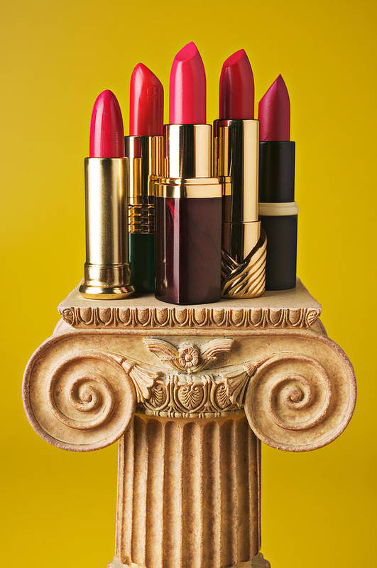 Cosmetics Poster featuring the photograph Five Red Lipstick Tubes On Pedestal by Garry Gay