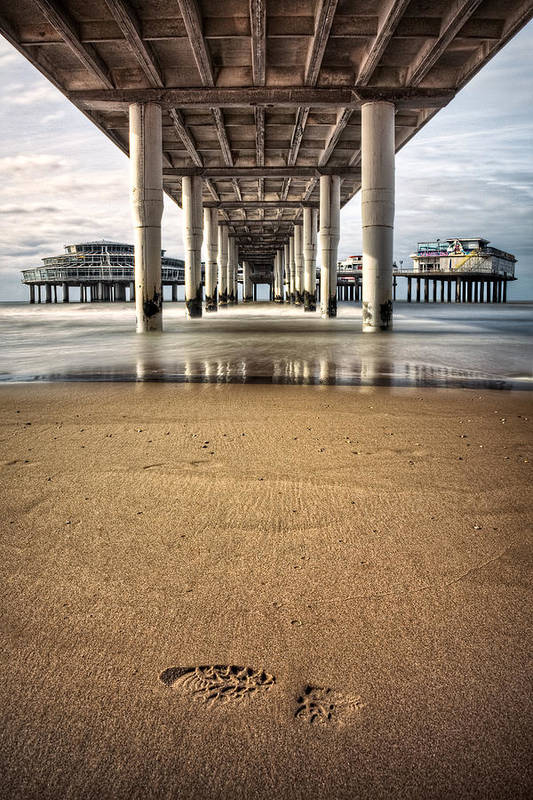 Piers Poster featuring the photograph Footprints In The Sand by Dave Bowman