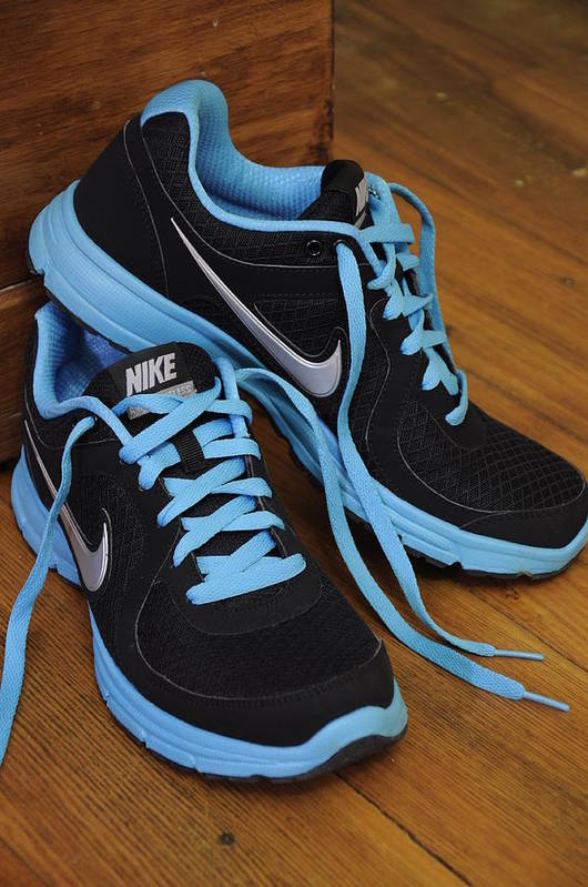 Nike Poster featuring the photograph Nike Shoes by Nicole Berna