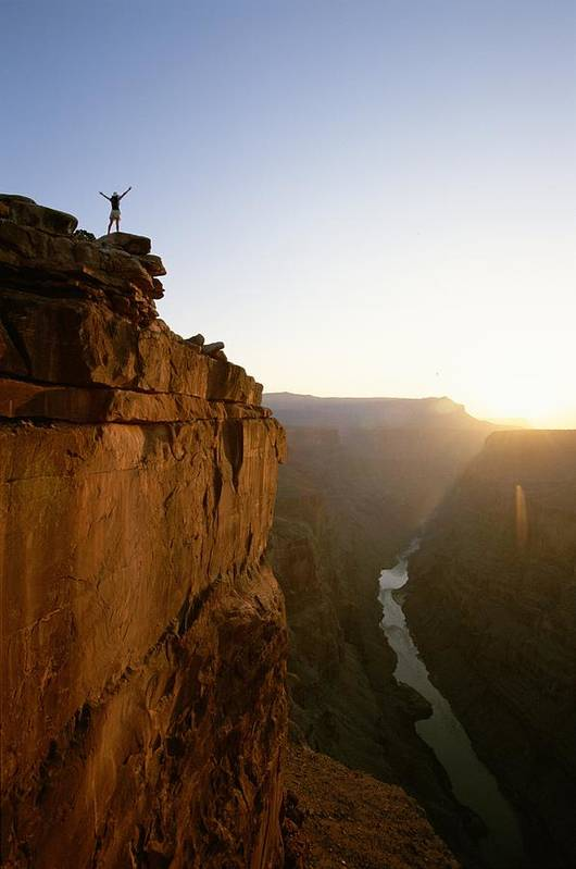 Human Actions And Reactions Poster featuring the photograph A Hiker Surveys The Grand Canyon by John Burcham