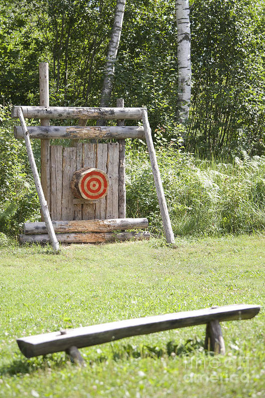 Bench Poster featuring the photograph Outdoor Wooden Bulls-eye by Jaak Nilson