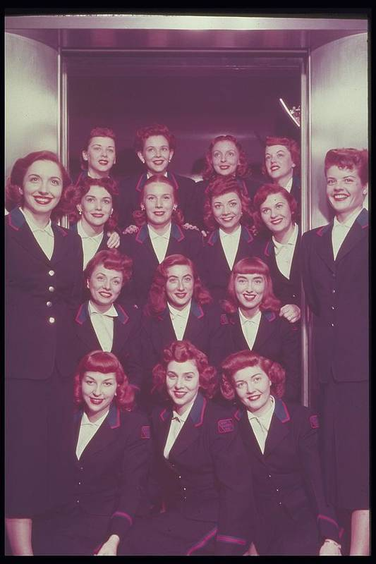 Adult Poster featuring the photograph Red Haired Women In Front Of Elevator by Archive Holdings Inc.