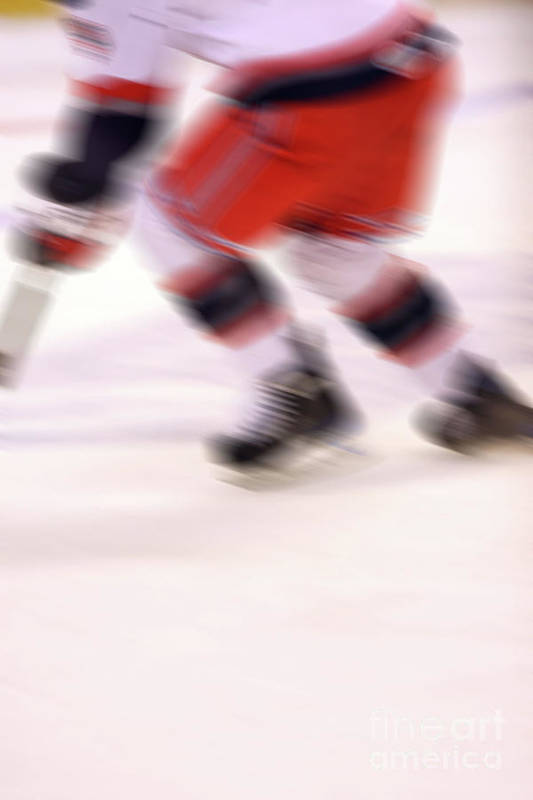 Hockey Poster featuring the photograph A Blur Of Ice Speed by Karol Livote