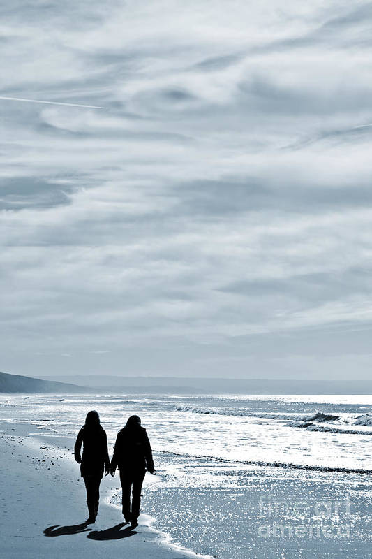 Women Poster featuring the photograph Two Women Walking At The Beach In The Winter by Jose Elias - Sofia Pereira
