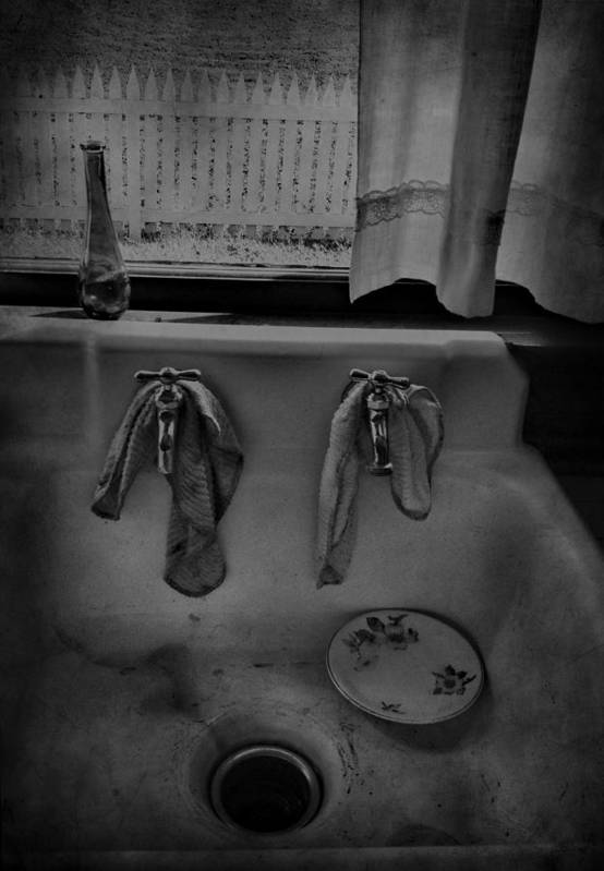 Sink Poster featuring the photograph Sinking Tears by Jerry Cordeiro