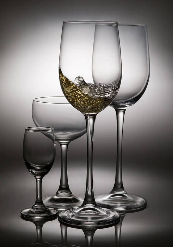 Abstract Poster featuring the photograph Splashing Wine In Wine Glasses by Setsiri Silapasuwanchai