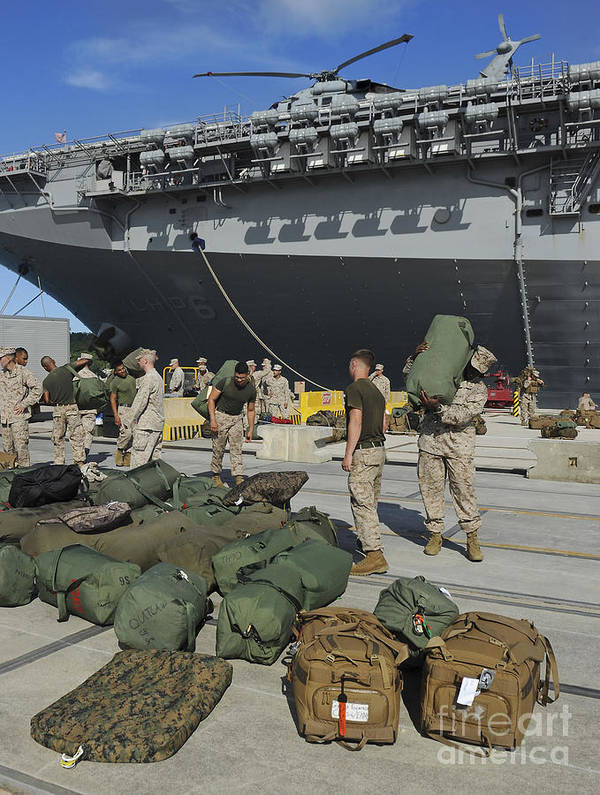 Uss Bonhomme Richard Poster featuring the photograph Marines Move Gear During An Embarkation by Stocktrek Images
