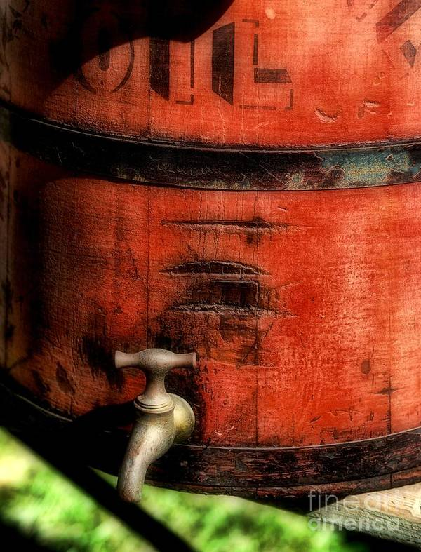 Weathered Red Oil Bucket Poster featuring the photograph Red Weathered Wooden Bucket by Paul Ward