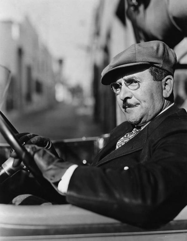 White Poster featuring the photograph Portrait Of Man In Drivers Seat Of Car by Everett