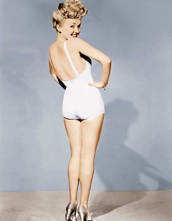 1940s Portraits Poster featuring the photograph Betty Grable, World War II Pin-up, 1943 by Everett