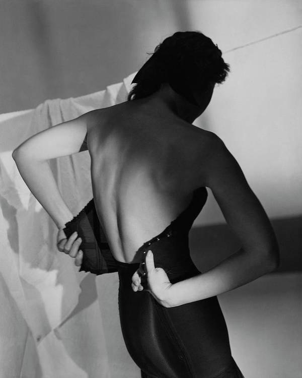 Fashion Poster featuring the photograph A Model Fastening Her Brassiere by Horst P. Horst