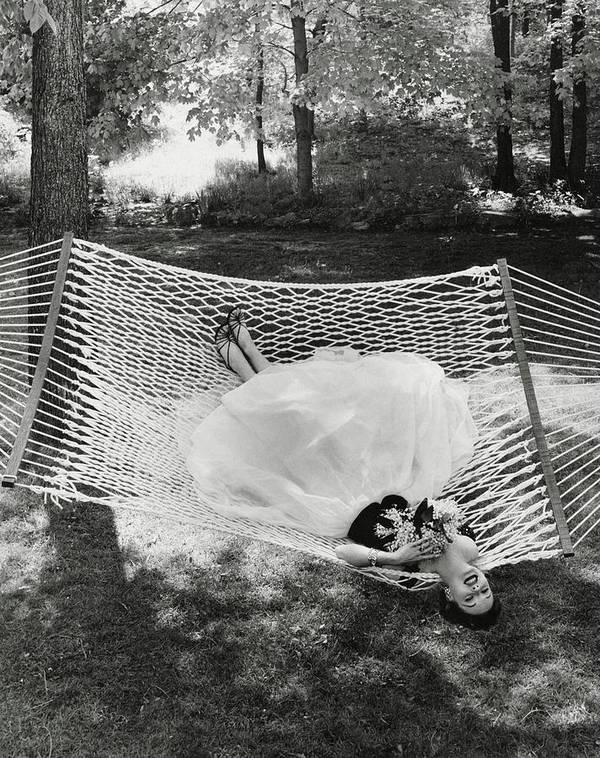 Landscape Poster featuring the photograph A Model Lying On A Hammock by Gene Moore