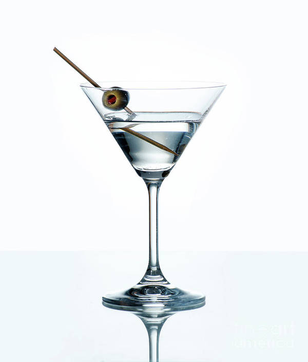 Dry Martini With Green Olive In Cocktail Glass Over White Backgr