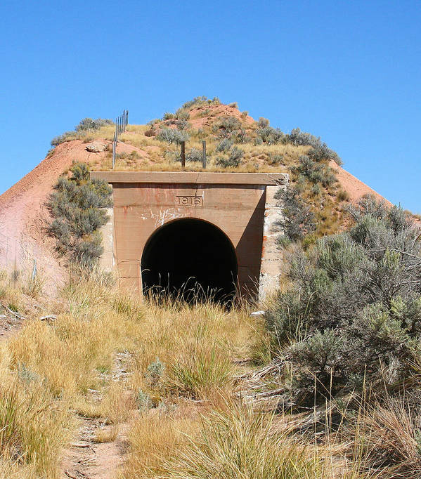Poster featuring the photograph Blue Sky Black Tunnel by Pat Turner