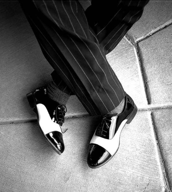 Black And White Photography Poster featuring the photograph Big Shoes Little Feet by Kenneth Carpenter