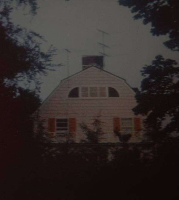 The Amityville Horror Poster featuring the photograph The Amityville Horror by Rob Hans
