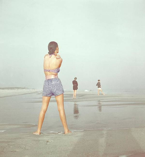 Fashion Poster featuring the photograph Back View Of Three People At A Beach by Serge Balkin