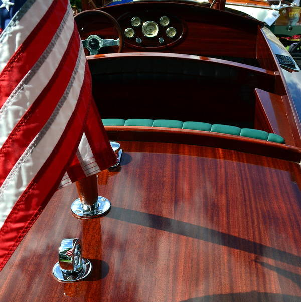 Classic Boat Poster featuring the photograph Chris Craft With Flag And Steering Wheel by Michelle Calkins