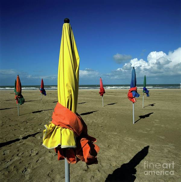 Basse Normandie Poster featuring the photograph Parasols Of Deauville by Bernard Jaubert