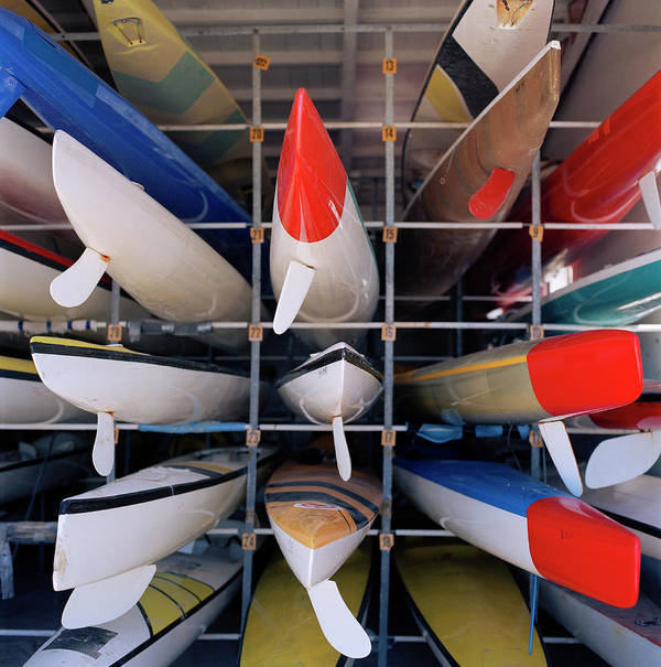 Sport Rowing Poster featuring the photograph Rows Of Canoes In Boat House, Close-up by Shoula