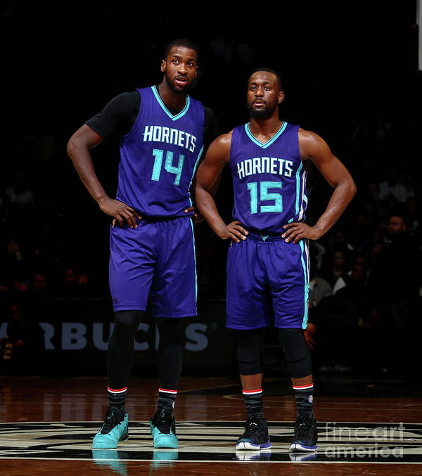 Kemba Walker Poster featuring the photograph Kemba Walker and Michael Kidd-gilchrist by Nathaniel S. Butler