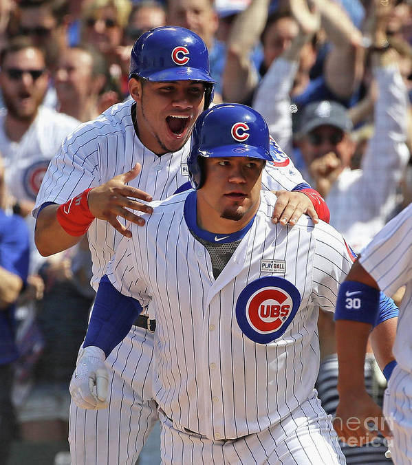 Three Quarter Length Poster featuring the photograph Kyle Schwarber and Willson Contreras by Jonathan Daniel