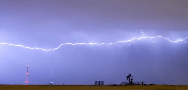 Lightning Poster featuring the photograph Long Lightning Bolt Strike Across Oil Well Country Sky by James BO Insogna