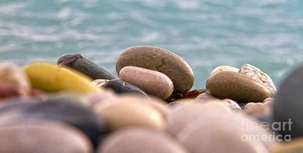 Abstract Poster featuring the photograph Beach And Stones by Stelios Kleanthous