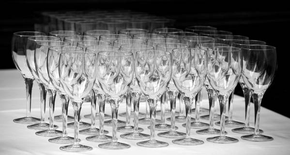 Kitchen; Dinner; Breakfast; Glasses; Clear; Many; Lots; Glass; Crystal; Crystal Glass; Crystal Glasses; Empty; Empty Glass; Empty Glasses; Black And White; Black & White; Table; Banquet; On A Table; On The Table; White; Black; Table Cloth; Light; Shadows; Abstract; In A Row; Row; Rows; Rows Of Glasses; Geometry; Svetlana Sewell Poster featuring the photograph Banquet Glasses by Svetlana Sewell