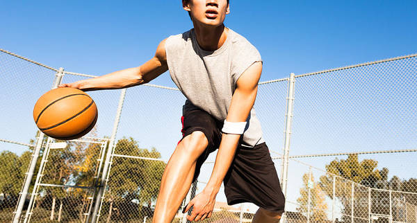 College Poster featuring the photograph Fit Male Playing Basketball Outdoor by Pkpix