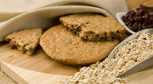 Food Poster featuring the photograph Oatmeal Raisin Cookie by Rob Outwater