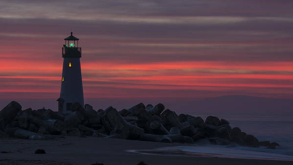Sunrise Poster featuring the photograph The Harbor Light At Dawn by Bruce Frye