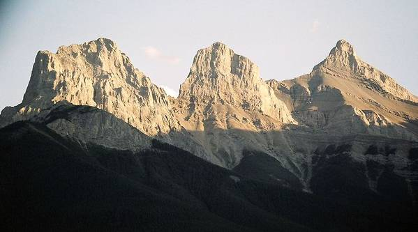 Rocky Mountains Poster featuring the photograph The Three Sisters Of The Rockies by Tiffany Vest