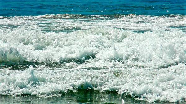 Ocean Waves Poster featuring the photograph Wading For A Sign by Jacqueline Howe