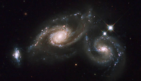 Twinkle Poster featuring the photograph A Triplet Of Galaxies Known As Arp 274 by Stocktrek Images