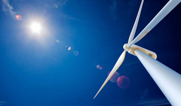 Wind Poster featuring the photograph Wind Turbine And Sun by Johan Swanepoel